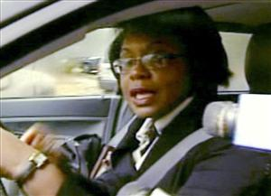 This still image from video provided by WCVB-TV in Boston shows Brandeis University professor Anita Hill driving from her home Wednesday.