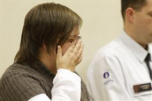 Els Clottemans wipes a tear as she is found guilty at a courthouse in Tongeren, Belgium.