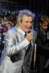In this publicity image released by ABC, singer Rod Stewart performs on the daytime talk show The View, Wednesday, Oct. 20, 2010 in New York.