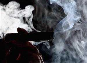 A man is seen smoking in a cigar shop March 20, 2006, in Glasgow, Scotland.