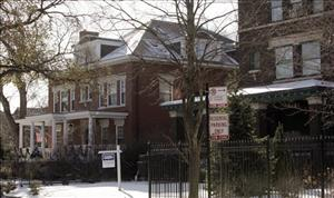 In this Dec. 10, 2009 file photo in Chicago, The home belonging to President Barack Obama and family, left, is pictured. The 17-room house next door, right, has been sold for $1.4 million.