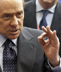 Italy's Prime Minister Silvio Berlusconi gestures while speaking during a media conference at an EU summit in Brussels on Friday, Oct. 29, 2010.