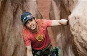 In this film publicity image released by Fox Searchlight Pictures, James Franco is shown in a scene from 127 Hours.