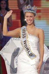 Alexandria Mills gestures after being crowned as 2010 Miss World at the Beauty Crown Cultural Center in Sanya, in southern China's island province Hainan, Saturday, Oct. 30, 2010.