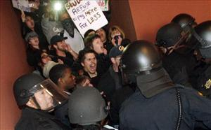 Protesters break the line of University of California police officers at the garage entrance to the University of California  Campus in San Francisco, Calif. on Wednesday Nov. 17, 2010.