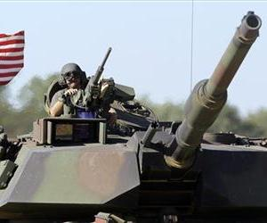 An Abrams tank drives on the new track at the US military's first center for sustained high-speed vehicle testing during a ceremony at Aberdeen Proving Ground, Sept. 8, 2010 in Aberdeen, Md.
