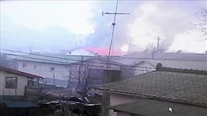 Houses set ablaze by North Korean artillery burn on South Korea's Yeonpyeong island.