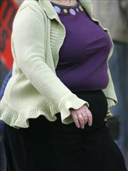 An overweight person is seen walking in London, Wednesday, Oct. 17, 2007.
