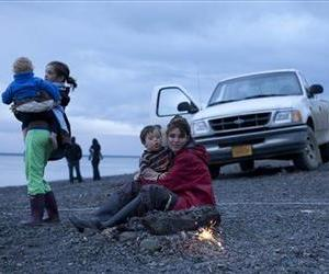 Sarah Palin holds her son Trig and watches fireworks on a beach in Dillingham, Alaska as her daughter Piper holds grandson Tripp Johnston in a scene from 'Sarah Palin's Alaska.'