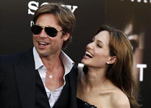 Cast member Angelina Jolie, right and Brad Pitt arrive at the premiere of Salt in Los Angeles, on Monday, July 19, 2010.