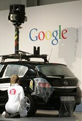 In this March 2, 2010 file photo, a woman decorates a camera car of Google at the CeBIT in Hannover, northern Germany.