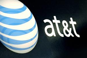 In this photo taken Monday, Oct. 19, 2009, the AT&T logo is seen in a RadioShack store in Gloucester, Mass.