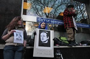 Supporters of Wikileaks founder Julian Assange gather outside the City of Westminster Magistrates Court in London yesterday.