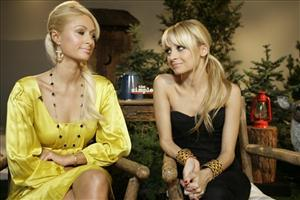 Paris Hilton, left, and Nicole Richie pose during an interview on set to promote their television show The Simple Life,  Monday, April 9, 2007, in Los Angeles.