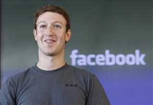 In this Nov. 15, 2010 file photo, Facebook CEO Mark Zuckerberg smiles at an announcement in San Francisco.