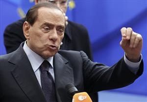 Italy's Prime Minister Silvio Berlusconi speaks during a media conference at an EU summit in Brussels, Friday, Dec. 17, 2010.