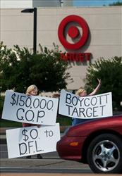 People protesting Target's donations stand outside a store in Minnesota.