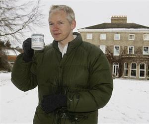 Julian Assange head of WikiLeaks takes a drink during a press conference at the home of Frontline Club founding member Vaughan Smith, at Bungay, England, Friday, Dec. 17, 2010.