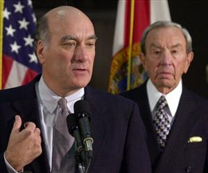William Daley, then Campaign Manager for Al Gore, briefs reporters at the Capitol in Tallahassee, in this Nov. 9, 2000 file photo, as former Secretary of State Warren Christopher (right) looks on.