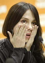 Mel Gibson's ex-girlfriend, Russian-born singer, songwriter Oksana Grigorieva, gestures during a news conference in Moscow, Monday, April 19, 2010.