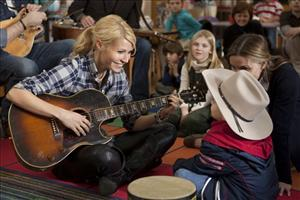 In this film publicity image released by Screen Gems, Gwyneth Paltrow is shown in a scene from Country Strong.