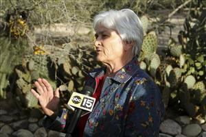 Patricia Maisch, 61, talks to the media outside her home in Tucson, Ariz., Sunday, Jan. 9, 2011.