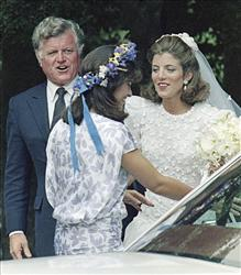 In this July 19, 1986, file photo, bride Caroline Kennedy, right, chats with her cousin and matron of honor, Maria Shriver, center,  during her wedding in Centerville, Mass., July 19, 1986.