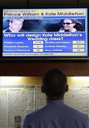 Video screen displays the betting odds for the designers of Kate Middleton's wedding dress at a bookmakers in central London. Gamblers are also making bets on a royal divorce.
