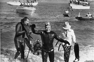IIn this Nov. 7, 1975 file photo, fitness expert Jack LaLanne, 61, comes out of the chilly water after a successful swim from the Marin County side along the Golden Gate Bridge to San Francisco.