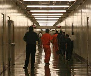In this April 13, 2009, file photo detainees leave the the cafeteria at the Stewart Detention Facility, a Corrections Corporation of America immigration facility in Lumpkin, Ga.