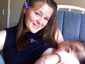 This undated photo provided by Kelli Roman shows her breastfeeding her daughter Ivy.
