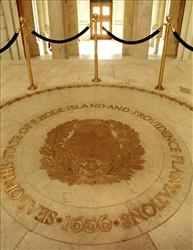 In this file photo, the seal of the State of Rhode Island is seen on the floor of the Statehouse rotunda In Providence.