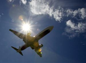 A Delta Airlines plane flies into Portland International Airport in Portland, Ore.