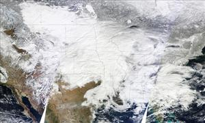 This image released by NASA shows how the snowstorm looks from space. The United States is under there somewhere.