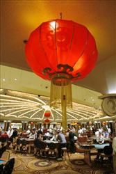A table game section is adorned with red Chinese lanterns at the Caesars Palace hotel-casino in Las Vegas in this Feb. 13, 2007 file photo.