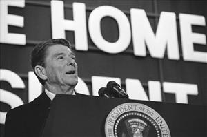 In this Feb. 7, 1984 file photo, President Ronald Reagan addresses a crowd of well-wishers gathered for a huge birthday party in the Dixon High School gymnasium in Dixon, Ill.