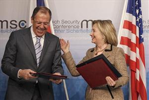 US Secretary of State Hillary Rodham Clinton, right, and Russia's Foreign Minister Sergey Lavrov smile after finalizing the New START treaty  during the Conference on Security Policy in Munich, Germany, Saturday, Feb. 5, 2011.