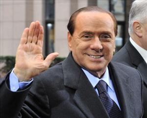Italian Prime Minister  Silvio Berlusconi arrives at the EU summit on February 4, 2011 at the European Council headquarters in Brussels.