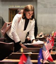 In a Monday, Feb. 7, 2011 photo, state Rep. Julia Hurley gathers her papers on the House floor in Nashville, Tenn.