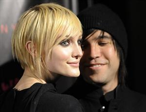 Ashlee Simpson-Wentz and her husband Pete Wentz arrive for a screening of Runaway, Oct. 18, 2010, in Los Angeles.