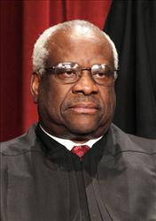 In this Oct. 8, 2010 file photo, Associate Justice Clarence Thomas is seen during the group portrait at the Supreme Court Building in Washington.