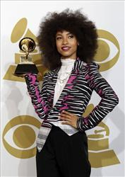 Esperanza Spalding poses backstage with the award for best new artist at the 53rd annual Grammy Awards in Los Angeles yesterday.
