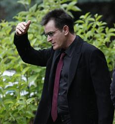 Charlie Sheen shields his face from the rain as he leaves the the Pitkin County Courthouse in Aspen, Colo., on Monday, Aug 2, 2010.