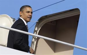 President Barack Obama boards Air Force One at Andrews Air Force Base, Md., Thursday, Feb. 17, 2011, en route to San Francisco.
