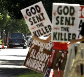 Protesters from Rev. Fred Phelps' Westboro Baptist Church demonstrate during 2009 funeral services for abortion provider Dr. George Tiller in Wichita, Kan.