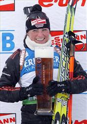 In this Feb. 12, 2011 file photo, Andrea Henkel poses with a large glass of Erdinger no-alcohol beer after winning the women's sprint race at the biathlon World Cup, in Fort Kent, Maine.