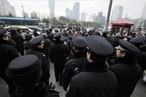 Police officers stand in front of a Shanghai cinema where protesters had been urged to gather.