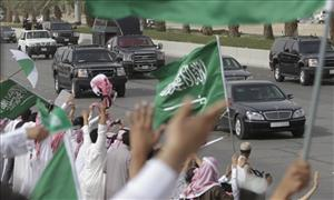 Saudis wave and cheer as the convoy of the King Abdullah of Saudi Arabia passes from the Airport and through the streets of Riyadh, Saudi Arabia, Wednesday, Feb. 23, 2011.