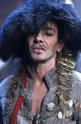 In this Jan. 21, 2011 file photo, British fashion designer John Galliano appears at the end of his men's fall-winter 2011/2012 fashion collection presented in Paris.