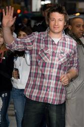 This March 23, 2010 photo shows Jamie Oliver as he leaves a taping of The Late Show with David Letterman in New York.